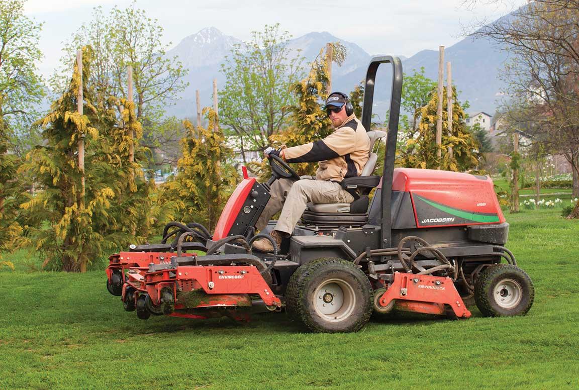 Man driving a lawn mower